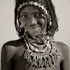 Afar girl smiling, Danakil desert, Ethiopia (Eric Lafforgue) Tags: portrait people haircut girl smile face square blackwhite necklace beads decoration culture tribal tribes tradition ethiopia ornate tribe jewels ethnic hairstyle beautifulpeople amulet tribo traditionalculture adornment ethnology headandshoulders tribu afar thiopien etiopia braidedhair ethiopie etiopa lookingatcamera statussymbol  traveldestination etiopija ethnie ethiopi 89years  etiopien etipia 0481  etiyopya     assayta      mg04812