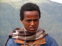 Children on Simien mountains (Linda DV) Tags: africa street travel portrait people cute face canon children geotagged kid child candid young kind ethiopia enfant 2010 travelphotography simienmountains travelportrait semienmountains powershots5is lindadevolder