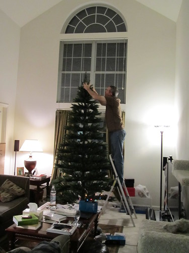 Rob puts the top on the tree!
