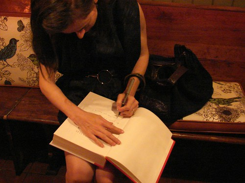 Amanda signs our copy of the book