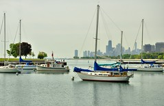 Montrose Harbor in HDR (Seth Oliver Photographic Art) Tags: chicago illinois nikon midwest skyscrapers cityscapes lakemichigan trumptower sailboats harbors hdr montroseharbor pinoy tugboats johnhancockbuilding chicagoskyline urbanscapes marinas chicagoist springseason d90 lakepointetower handheldshot pseudohdr boatingseason setholiver1 nd4xfilter 18105mmnikkorlens aperture90 0006secondexposure highdynamicimages montroseharborlighthouses