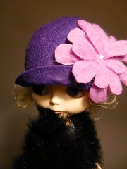 Oversized pink felt flower on purple hat
