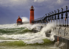 """October Gale"" Grand Haven lighthouse, Grand Haven Michigan (Michigan Nut) Tags: red usa lighthouse seascape storm color green art beach nature weather clouds landscape geotagged waves lakemichigan explore nautical frontpage recent grandhavenlighthouse d700"