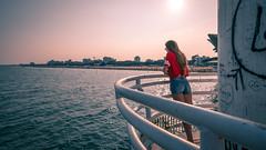 The girl in red - Lignano sabbiadoro, Italy - Color street photography (Giuseppe Milo (www.pixael.com)) Tags: streetphotography sun lines beach girl sunset sunglasses tshirt urban fashion city faceless sea leading red hair lignanosabbiadoro friuliveneziagiulia italy it onsale