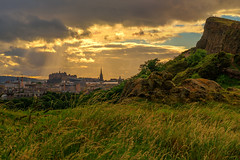 The sun's rays over Auld Reekie (MilesGrayPhotography (AnimalsBeforeHumans)) Tags: architecture auldreekie britain blending balmoralclocktower city cityscape castle castlerock dusk edinburgh europe evening fe sonyfe2870mmf3556oss glow golden goldenhour grass haze historicscotland historic iconic ilce7m2 landscape lens nd outdoors photography photo tranquil rocks scotland skyline sky clouds sunset sunshine sunlight summer sony sonya7ii oss a7ii town uk unitedkingdom volcano volcanic rays raysoflight light