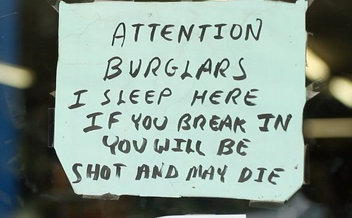 Attention burglars I sleep here if you break in you will be shot and may die