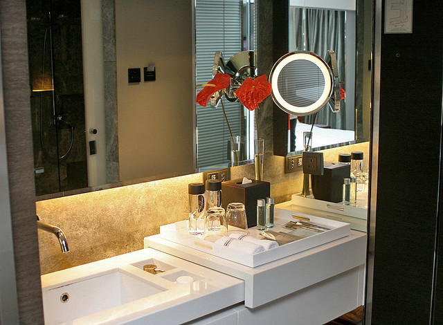 Gorgeous mirrored vanity area - I learned too late that the top actually slides to cover the sink!