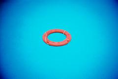 life belt (lomokev) Tags: blue espaa water pool circle lomo lca lomography spain lifebelt kodak lomolca ring swimmingpool lomograph swiming lifering ektar safty espaa kodakektar100 file:name=100702lomolcaektar154 roll:name=100702lomolcaektar