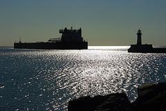 The Shining Sea (dorothy mae) Tags: blue sea lighthouse silhouette harbor ship ripples shining lakesuperior ripplingwater mygearandmepremium mygearandmebronze