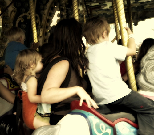 babywearing on the merry go round