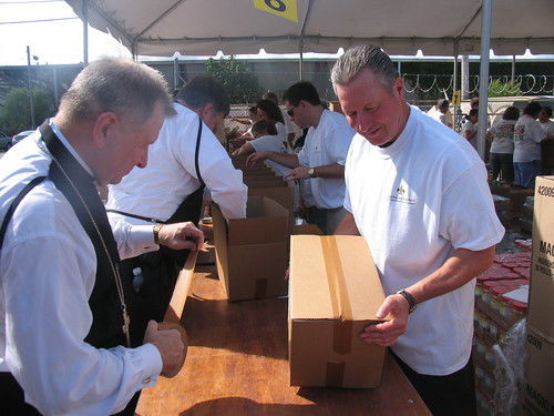 Southwest Region RA Ludwig and Archbishop Gregory Michael Aymond volunteered to assemble emergency food boxes at the Second Harvest Food Bank of Greater New Orleans and Acadiana