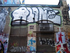 ALONE (Rob React) Tags: street cambridge art boston graffiti stencil alone paste wheat vault od dfm blud