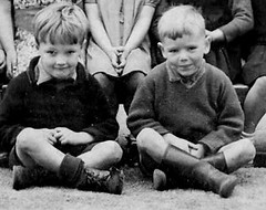 Worn out boots. (theirhistory) Tags: school boy outdoors photo kid shoes child boots group class jumper shorts form schoolphoto seated wellies classphoto laceupboots