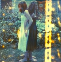 alter ego (marion (milky soldier)) Tags: 2 garden polaroid sx70 friendship barefeet sisterhood timezero whiteandblack womanhood sx70film romydaketh