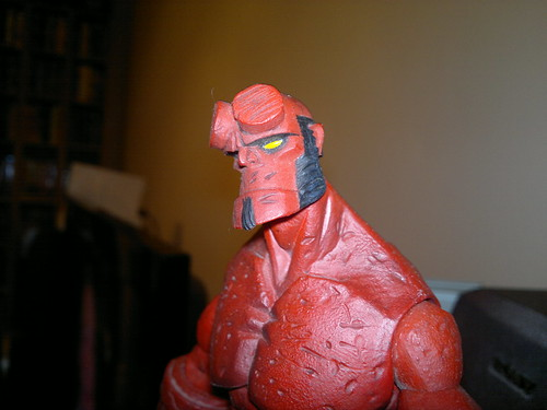 red figure figurine hellboy