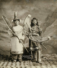 Tlingit man and woman in full dancing costumes, Alaska (UW Digital Collections) Tags: alaska hats nosering facepaint studioportrait tlingit crowns paddles septumpiercing tunics tlingittribe frankhnowell kawclaa potlatchdancingcostume ceremonialfacepaint tlingitwoman potlatchcostume tlingitman tlingitcouple