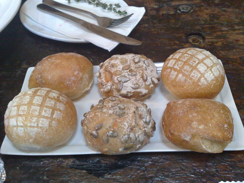 assortment of bread, served with the mushroom, avocado and truffle 'carpaccio'