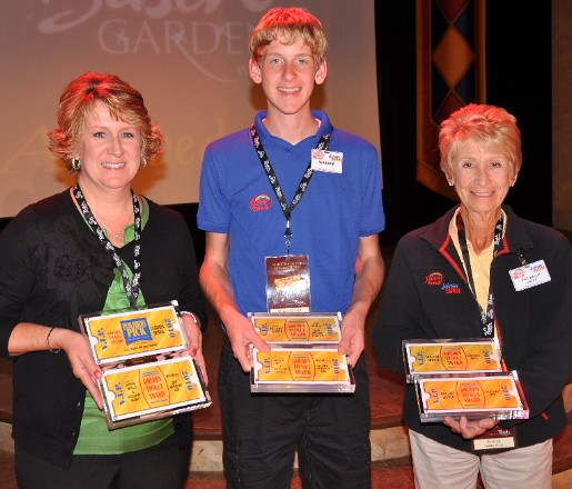Lori, William and Pat Koch hold the park's 2010 Golden Ticket Awards.