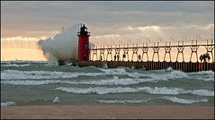 South Haven Splash (Tom Gill.) Tags: lighthouse lake pier day waves wind cloudy michigan gale lakemichigan greatlake southhaven regionwide