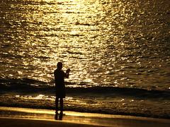 Photographing the photographer (DaveKav) Tags: sunset sea orange france reflection beach silhouette golden dusk olympus silhoette euskalherria euskadi paisvasco baskenland paysbasque saintjeandeluz stjeandeluz e510 dold