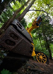 Tread Softly (Prestidigitizer) Tags: industry yellow forest bravo forestry logging machine wideangle ultrawide powellriver treads pentaxk10d sigma816mm