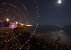 The orb appeared from the vortex and hovered a while (Leonski) Tags: light sea moon ball painting spiral sussex photo seaside brighton long exposure image photos pics picture orb pic pebbles moonlight leonski
