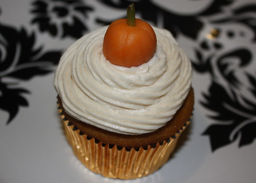 Pumpkin Spice Cupcake with Cinnamon Rum Frosting and Marzipan Pumpkin