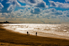 scheveningen at sea (drbob97) Tags: mywinners tripleniceshot mygearandmepremium mygearandmebronze mygearandmesilver mygearandmegold mygearandmeplatinum mygearandmediamond becauseofthestrongsunlight igetastraingebacklight itsgivesaspecialeffectofwarmcolorsscheveningenatseabeachwalkwalkingzeewandelenluchtzonsunlightlightlichttegenlichtskybluedrbobdrbob97