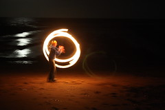 Firebending (fire poi) (Sarah Ross photography) Tags: standrews studyabroad semester scotland uk sarahr89 sarahrossphotography fire poi firepoi firedancing twirl spin throw bend longexposure beach castlesands trick flaming curve curves curved circle circular circles light lighting round lights contrast dark