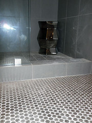Bathroom floor tiled in nickels