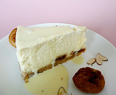 Tall and creamy cheesecake topped with Amaretto creme anglaise (Brown Eyed Baker) Tags: dessert cheesecake