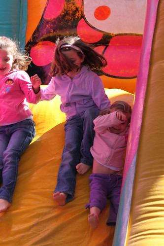 Kids on jumping castle slide
