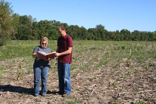 Megan Andrews, Resource Conservationist for Kendall County SWCD, and Jason Pettit, Director of Kendall County Forest Preserve District, review restoration plans for the Recovery Act project.