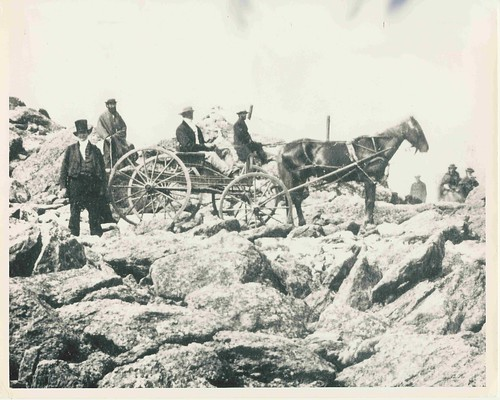Joseph M. Thompson insures his place in history by driving the first horse drawn wagon to the summit on the Mt Washington Carriage Road - three weeks before the official opening day.