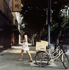 A girl of the cafe front ( ken ) Tags: street 120 6x6 film girl bicycle kodak taiwan taipei greatwall   portra160vc   tunhua t