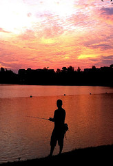 Fishing (wongyokeseong) Tags: sunset people lake fish reflection apple water silhouette fishing pond singapore flickr candid watching lakeside sin  iphone  fli     appleiphone