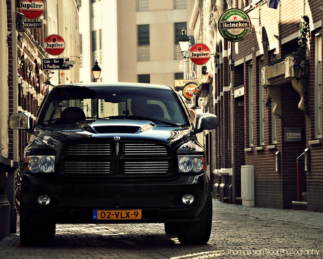 road lighting street city light sunlight black holland color reflection classic cars colors dutch lines car contrast truck vintage dark nose photography mirror design cool model alley nikon streetlight warm power thomas muscle expression centre great ad engine nederland style pickup automotive spot front exotic chrome american massive beast dodge modified headlight hemi grille nikkor ram frontal heavy breda executive import zwart centrum v10 2010 srt10 18105 nac d90 smalle quadcab rooij 83l thomasvanrooij dodgeramsrt10quadcab