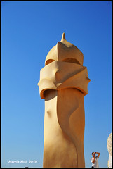 There is a Person in Your Frame! - La Pedrera Barcelona N4302e (Harris Hui (in search of light)) Tags: barcelona travel blue roof light shadow vacation portrait sky canada art rooftop architecture vancouver composition spain nikon perfect europe photographer bc apartment candid bluesky richmond gaudi warrior peopletakingpictures candidcamera casamila lapedrera d300 candidportrait antonigaudi chimmney travelphotography 18200mm greatarchitect greatartist nikon18200mmvr greatarchitecture whatisperfect nikond300 harrishui vancouverdslrshooter visitorintheframe