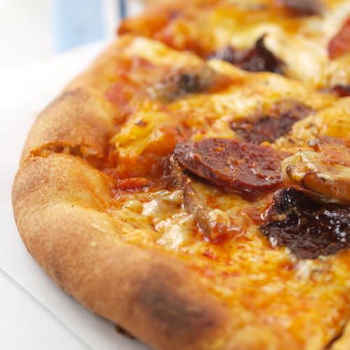 Chorizo, Candied Bacon, Caramelized Onion, and Mushroom Pizza