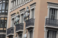 Building decorated with iron railings & umbrellas, Barcelona, Spain (aadair4) Tags: barcelona spain iron umbrellas railings img9848