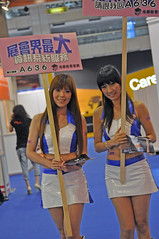 Short and sweet (Roving I) Tags: signs events models longhair taiwan taipei shortskirts promotions expos tradeshows baremidriffs excotaiwan