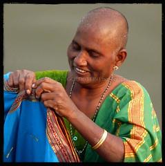 Contentment Alone (designldg) Tags: portrait people woman india water smile square colours skin expression religion atmosphere happiness devotion varanasi shanti hindu hinduism kashi ganga ganges benares benaras femininity uttarpradesh