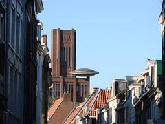 Urban Invasion (indigo_jones) Tags: holland building brick netherlands architecture utrecht rooftops sunday nederland bluesky ufo spaceship flyingsaucer zondag artinstallation gebouw inkpot binnenstad
