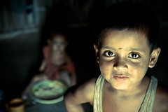 UCD (Universal childrens day) (Shad0w_0f_Dark) Tags: light boy food girl eyes child naturallight indoor discovery sylhet bangladesh 2010 burs higin volagonj