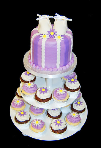 purple baby shower cupcake tower with daisies and booties