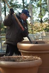 Repotting at Longwood Gardens (John Flinchbaugh) Tags: mark pots soil shovel planter longwoodgardens terracerestaurant strobist nikkor50mmseriesef18
