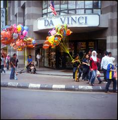ballon...ballon (fuadabd) Tags: street film mediumformat candid ballon crowd hijab kodakektarcolor160