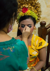 A woman applying makeup to a teenage girl in traditional costume before a tooth filing ceremony, Bali island, Canggu, Indonesia (Eric Lafforgue) Tags: asia asian bali bali2055 balinese barong beliefs canggu ceremony clothing colorimage customs dress filing hindu hinduism indigenouspeople indonesia indonesian indonesianculture indoors makeup mesangih realpeople rite rites ritual spiritual toothfiling tradition traveldestination vertical baliisland