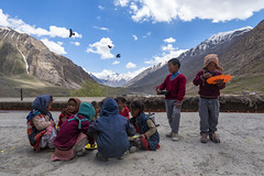 Lunch Time [Explored] (Ravikanth K) Tags: 500px kids school children lunch time lunchtime outdoor mountains hills snow capped clouds birds flying orange plate underthesky eating food break spiti spitivalley pinvalley valley himachal pradesh india mud mudh village