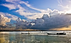Meghna: the widest river in Bangladesh (Mashroor NitoL) Tags: blue sky cloud sun white color reflection water yellow canon river landscape boat wave dslr bangladesh meghna lightroom 18mm widest